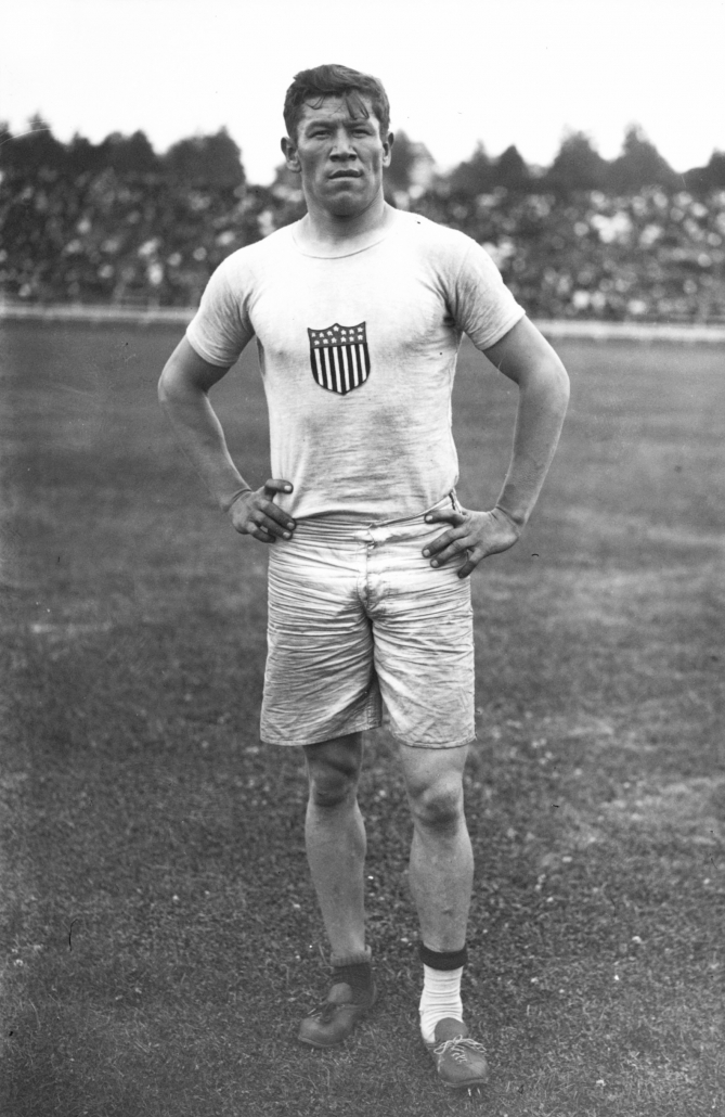 Thorpe with mismatched shoes in the 1912 Olympics